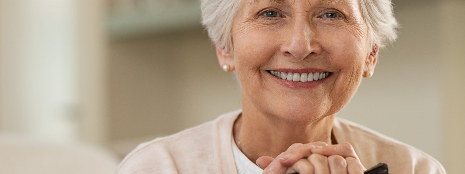 Older woman with pretty teeth smiling. This is dental work done right