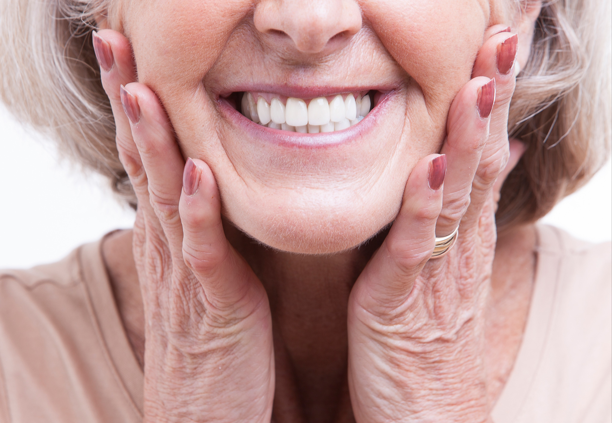 Woman smiling at newly cleaned white teeth
